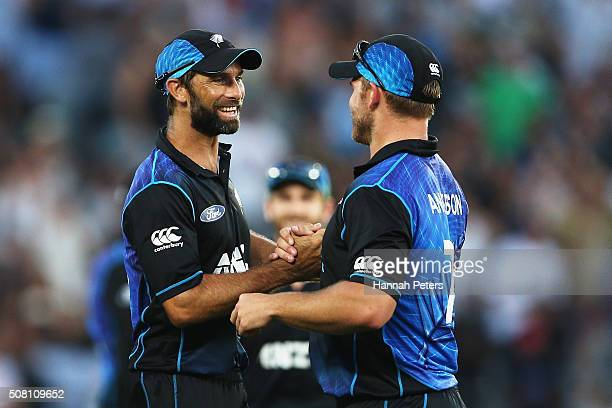 Grant Elliott of the Black Caps celebrates with Corey Anderson of the Black Caps after winning the One Day International match between New Zealand...