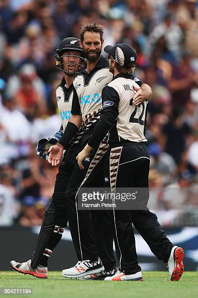 Grant Elliott of the Black Caps celebrates with Luke Ronchi and Kane Williamson after claiming the wicket of Tillakaratne Dilshan of Sri Lanka during...