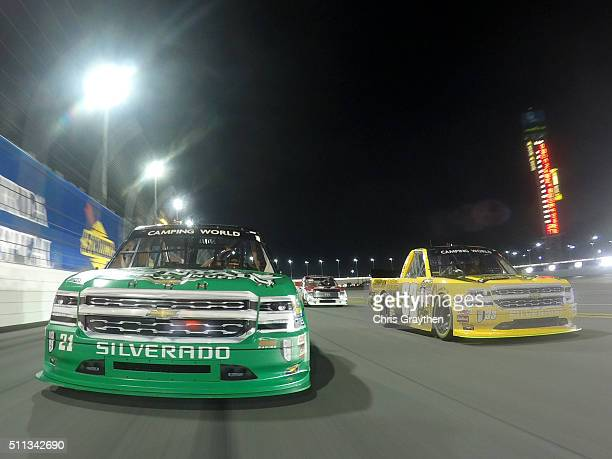 Grant Enfinger driver of the Champion Power Equipment Chevrolet and Johnny Sauter driver of the Smokey Mountain Herbal Snuff Chevrolet lead the field...