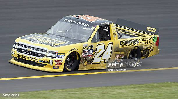 Grant Enfinger driver of the Champion Power Equipment Chevrolet practices for the NASCAR Camping World Truck Series Buckle Up In Your Truck 225 at...