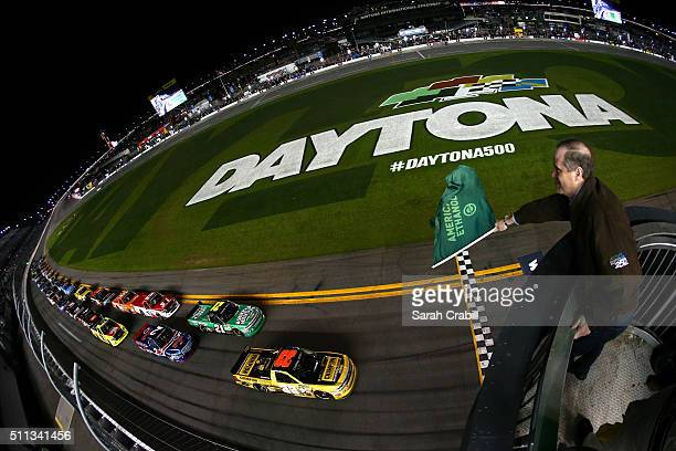 Grant Enfinger driver of the Champion Power Equipment Chevrolet leads the field to the green flag to start the NASCAR Camping World Truck Series...