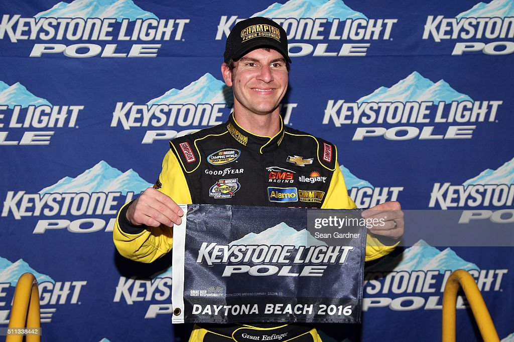 Grant Enfinger, driver of the #33 Champion Power Equipment Chevrolet, poses with the Keystone Light Pole Award after qualifying for the pole position for the NASCAR Camping World Truck Series NextEra Energy Resources 250 at Daytona International Speedway on February 19, 2016 in Daytona Beach, Florida.