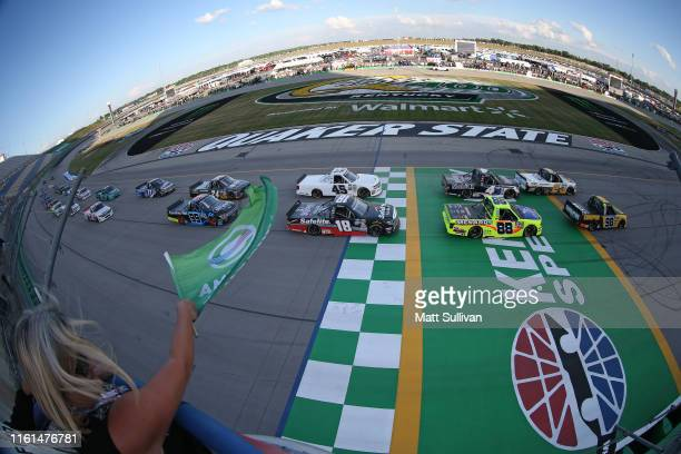 Grant Enfinger driver of the Champion Power Equipment Ford and Sheldon Creed driver of the Chevrolet Accessories Chevrolet take the green flag to...