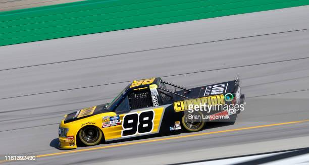 Grant Enfinger driver of the Champion Power Equipment Ford drives during practice for the NASCAR Gander Outdoor Truck Series Buckle Up In Your Truck...