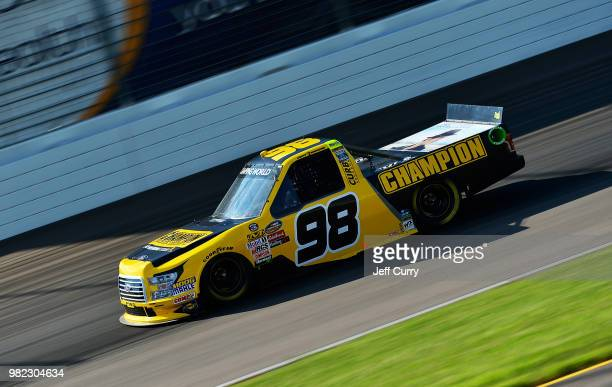 Grant Enfinger driver of the Champion Power Equipment Ford drives during qualifying for the NASCAR Camping World Truck Series Villa Lighting delivers...
