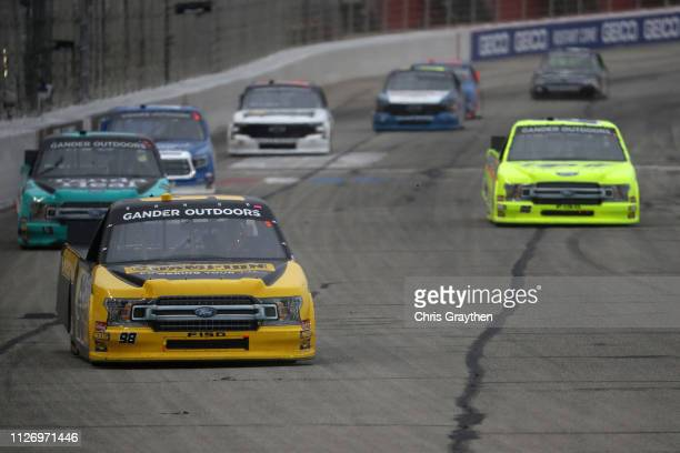 Grant Enfinger driver of the Champion Power Equipment Ford leads a pack of cars during the NASCAR Gander Outdoors Truck Series Ultimate Tailgating...