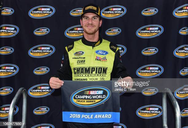 Grant Enfinger driver of the Champion Power Equipment/Curb Records Ford poses with the pole award after qualifying for the NASCAR Camping World Truck...