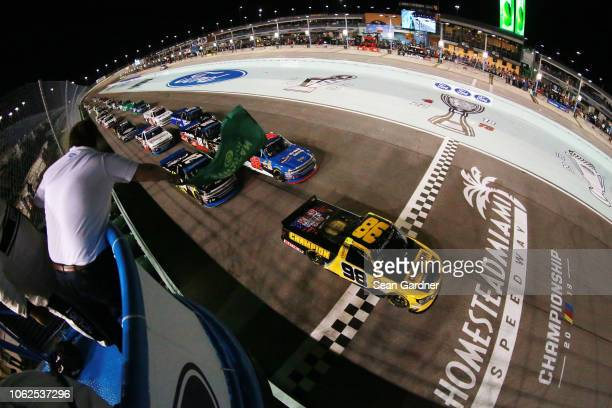 Grant Enfinger driver of the Champion Power Equipment/Curb Records Ford leads the field at the start of the NASCAR Camping World Truck Series Ford...