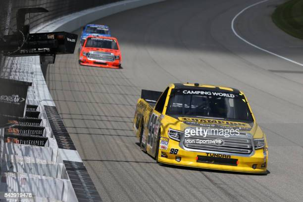 Grant Enfinger driver of the Champion Power Equipment/Curb Records Toyota races during the Camping World Truck Series LTi Printing 200 race on August...