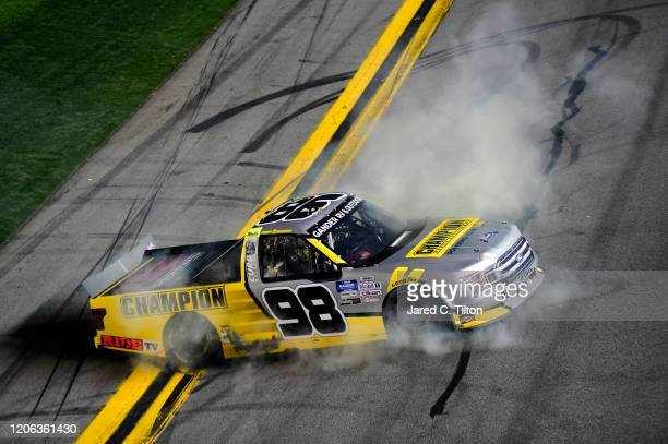 Grant Enfinger driver of the Champion/Curb Records Ford celebrates with a burnout after winning the NASCAR Gander RV Outdoors Truck Series NextEra...