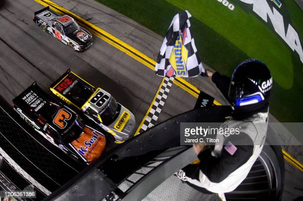 Grant Enfinger driver of the Champion/Curb Records Ford crosses the finish line ahead of Jordan Anderson driver of the KSeal/Bommaritocom Chevrolet...