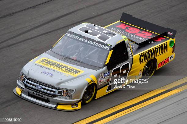 Grant Enfinger driver of the Champion/Curb Records Ford qualifies for the NASCAR Gander RV Outdoors Truck Series NextEra Energy 250 at Daytona...