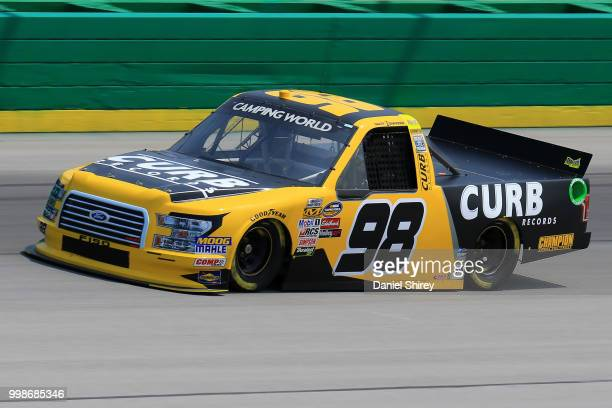 Grant Enfinger driver of the Curb Records Ford practices for the NASCAR Camping World Truck Series Buckle Up in Your Truck 225 at Kentucky Speedway...