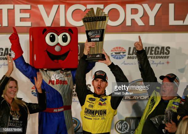 Grant Enfinger driver of the Ford celebrates with the trophy in Victory Lane after winning the NASCAR Camping World Truck Series World of Westgate...