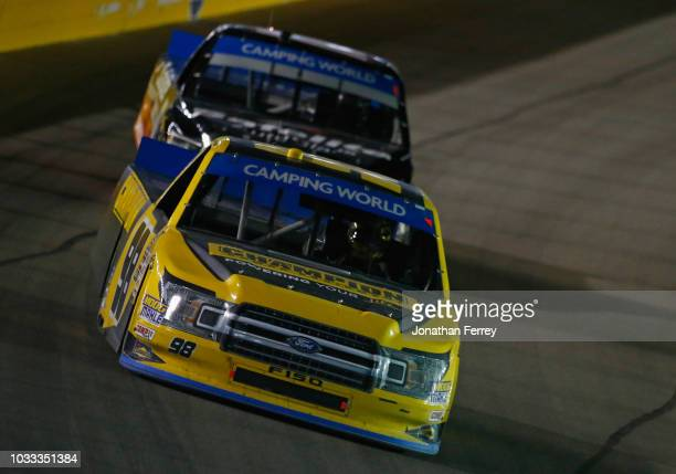 Grant Enfinger driver of the Ford leads a pack of trucks during the NASCAR Camping World Truck Series World of Westgate 200 at Las Vegas Motor...