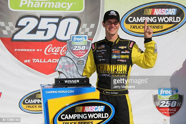 Grant Enfinger driver of the Plugfones Chevrolet celebrates in Victory Lane after winning after the NASCAR Camping World Truck Series fred's 250 at...