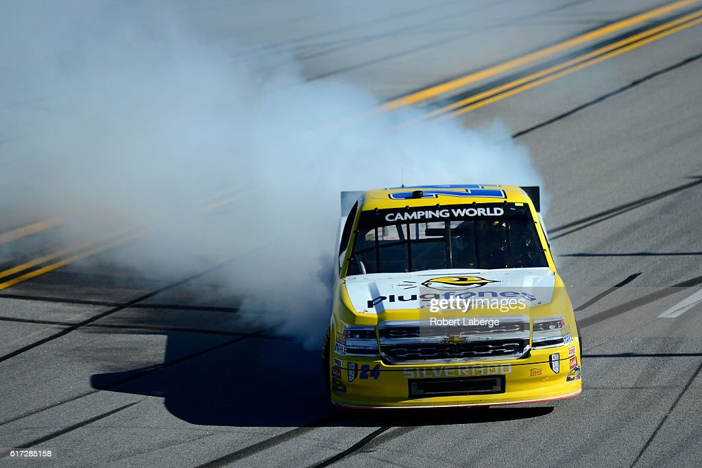 Grant Enfinger, driver of the #24 Plugfones Chevrolet, celebrates with a burnout after winning the NASCAR Camping World Truck Series fred's 250 at Talladega Superspeedway on October 22, 2016 in Talladega, Alabama.