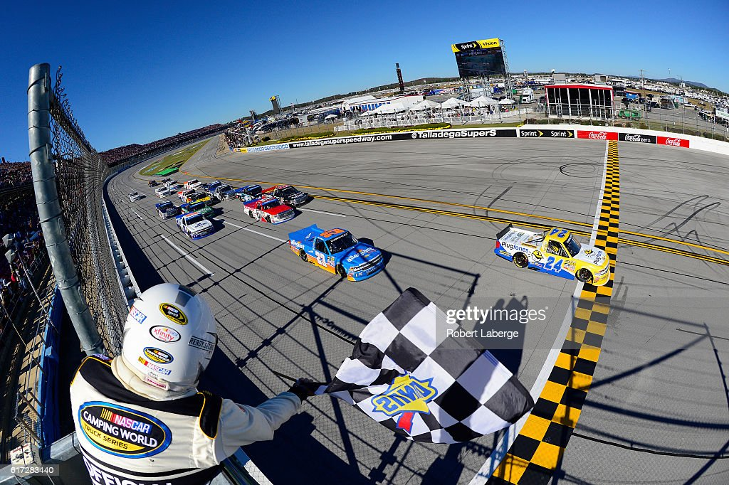 Grant Enfinger, driver of the #24 Plugfones Chevrolet, takes the checkered flag to win the NASCAR Camping World Truck Series fred's 250 at Talladega Superspeedway on October 22, 2016 in Talladega, Alabama.