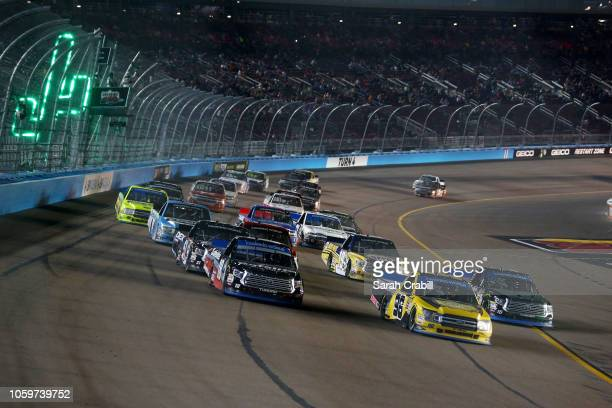Grant Enfinger driver of the Protect The Harvest/Curb Records Ford Noah Gragson driver of the Safelite AutoGlass Toyota and Brett Moffitt driver of...
