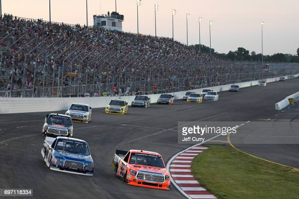 Grant Enfinger driver of the Ride TV Toyota Tundra leads a pack of trucks during NASCAR Camping World Trucks Series Drivin' for Linemen 200 at...