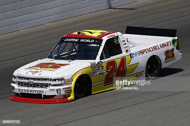 Grant Enfinger driver of the Spencer Clark Foundation Chevrolet during practice for the NASCAR Camping World Truck Series Careers for Veterans 200 at...