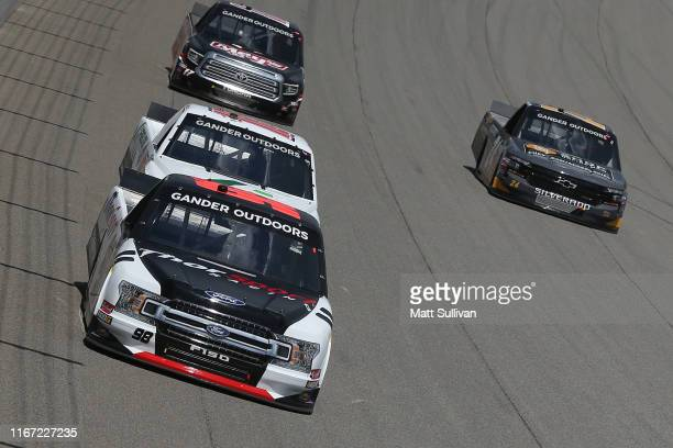 Grant Enfinger driver of the ThorSport Racing/Curb Records Ford leads a pack of trucks during the NASCAR Gander Outdoor Truck Series Corrigan Oil 200...
