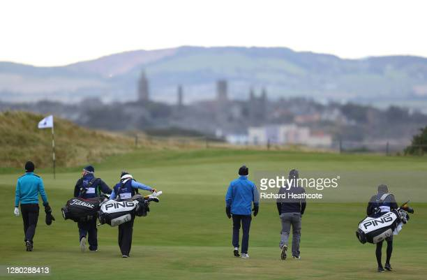 Grant Forrest of Scotland Eddie Pepperell of England and Brandon Stone of South Africa walk down the 11th hole during the first round of the Scottish...