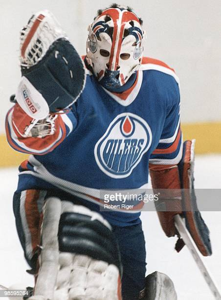 Grant Fuhr of the Edmonton Oilers defends the net in a circa 1980s game