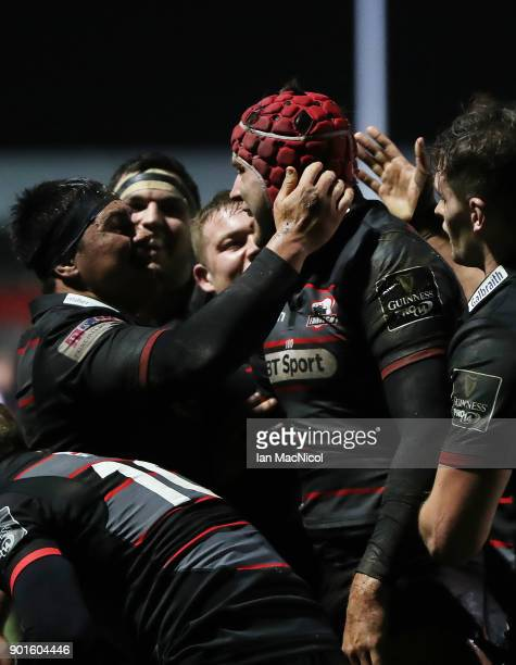 Grant Gilchrist of Edinburgh Rugby is congratulated by team mates after he scores his side's first try during the Guinness Pro14 match between...