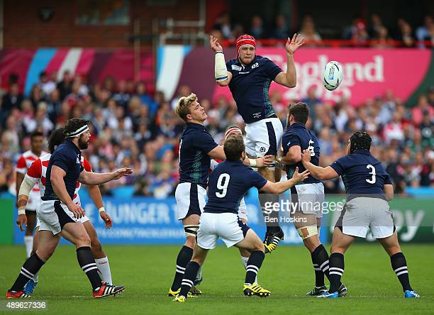 Grant Gilchrist of Scotland offloads the lineout ball during the 2015 Rugby World Cup Pool B match between Scotland and Japan at Kingsholm Stadium on...