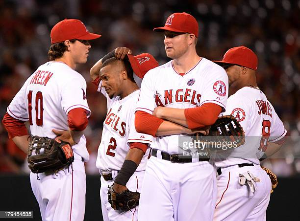 Grant Green Erick Aybar Mark Trumbo and Luis Jimenez of the Los Angeles Angels react during a pitching change to bring in Joe Blanton to face the...
