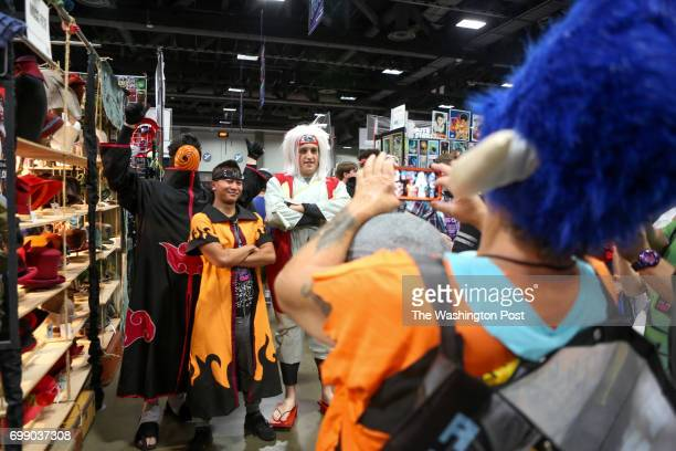 Grant Griffeth from Westminster Md dressed as Tobi from Naruto Jack Cao of Springfield Md dressed as Naruto and Kade Grevas of Pittsburgh dressed as...