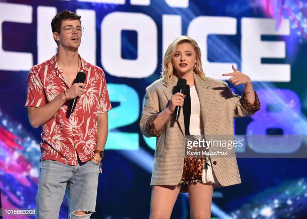 Grant Gustin and Chloë Grace Moretz attend FOX's Teen Choice Awards at The Forum on August 12 2018 in Inglewood California