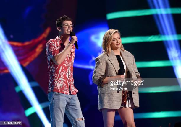 Grant Gustin and Chloë Grace Moretz speak onstage during FOX's Teen Choice Awards at The Forum on August 12 2018 in Inglewood California