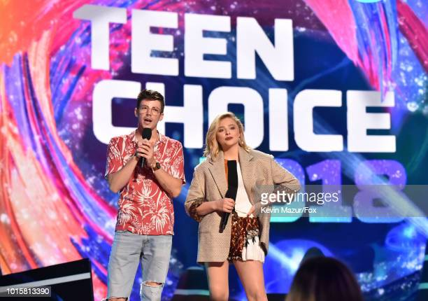 Grant Gustin and Chloe Grace Moretz speak onstage during FOX's Teen Choice Awards at The Forum on August 12 2018 in Inglewood California
