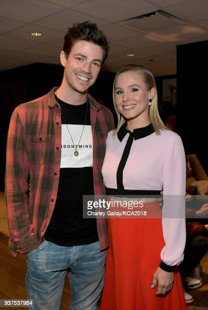 Grant Gustin and Kristen Bell attend Nickelodeon's 2018 Kids' Choice Awards at The Forum on March 24 2018 in Inglewood California