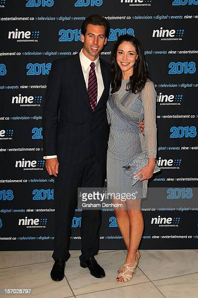 Grant Hackett and Giaan Rooney pose as they arrive at the Nine 2013 program launch at Myer on November 28 2012 in Melbourne Australia