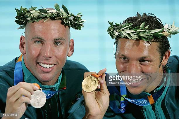 Grant Hackett and Ian Thorpe of Australian pose with their medals after the men's swimming 400 metre freestyle final on August 14, 2004 during the...