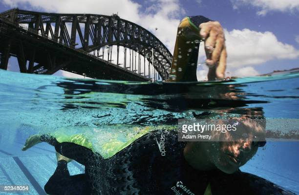 Grant Hackett of Australia Swims in North Sydney Pool under the Sydney Harbour Bridge during the Swimming Australia Speedo Sponsorship Launch on...