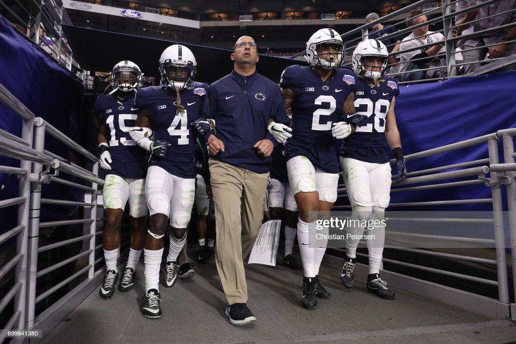 Grant Haley #15, Nick Scott #4, head coach James Franklin, Marcus Allen #2 and Troy Apke #28 of the Penn State Nittany Lions walk out to field arm in arm before the start of the second half of the Playstation Fiesta Bowl against the Washington Huskies at University of Phoenix Stadium on December 30, 2017 in Glendale, Arizona. The Nittany Lions defeated the Huskies 35-28.