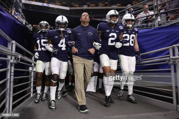 Grant Haley Nick Scott head coach James Franklin Marcus Allen and Troy Apke of the Penn State Nittany Lions walk out to field arm in arm before the...