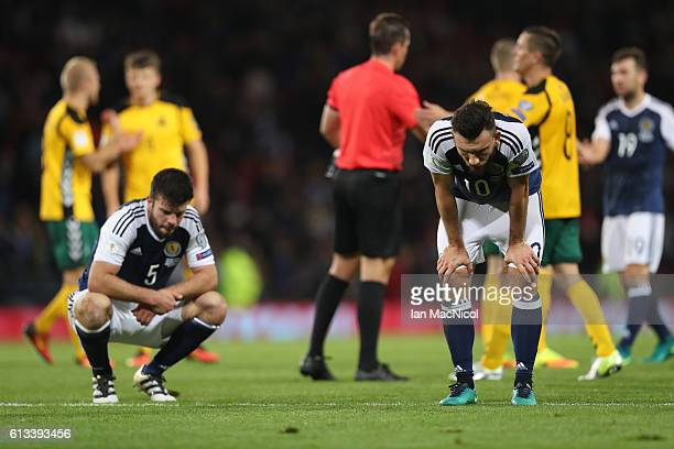 Grant Hanley and Robert Snodgrass of Scotland reacts at full time during the FIFA 2018 World Cup Qualifier between Scotland and Lithuania at Hampden...