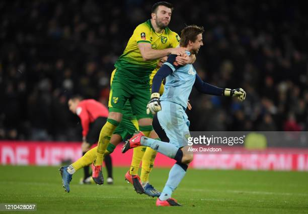 Grant Hanley and Tim Krul of Norwich City celebrate after winning the penalty shootout in the FA Cup Fifth Round match between Tottenham Hotspur and...