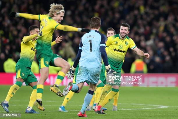 Grant Hanley of Norwich celebrates with goalkeeper Tim Krul after they go through on penalties during the FA Cup Fifth Round match between Tottenham...