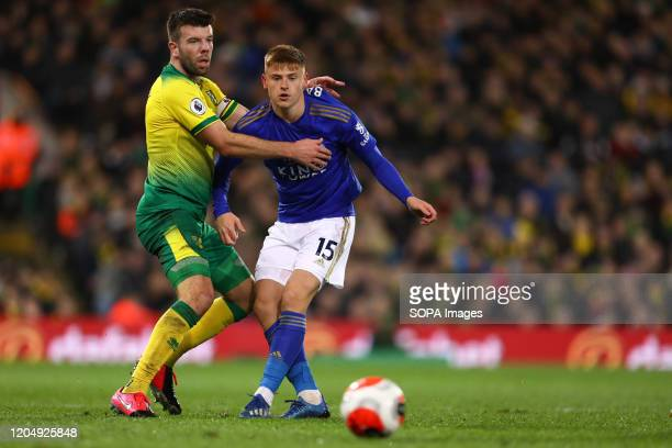 Grant Hanley of Norwich City and Harvey Barnes of Leicester City in action during the Premier League match between Norwich City and Leicester City at...