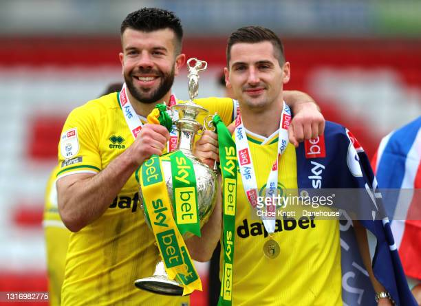 Grant Hanley of Norwich City and Kenny McLean of Norwich City pose with the Sky Bet Championship trophy during the Sky Bet Championship match between...