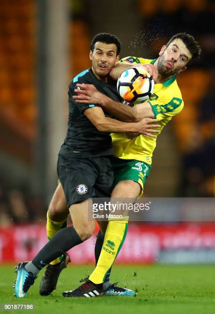 Grant Hanley of Norwich City is challenged by Pedro of Chelsea during The Emirates FA Cup Third Round match between Norwich City and Chelsea at...