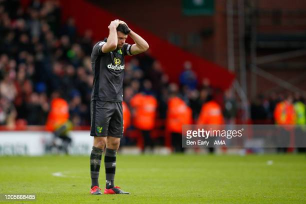 Grant Hanley of Norwich City looks dejected after the Premier League match between Sheffield United and Brighton & Hove Albion at Bramall Lane on...