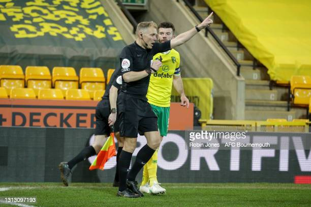 Grant Hanley of Norwich City protests as Referee Graham Scott awards a goal to Sam Surridge of Bournemouth during the Sky Bet Championship match...