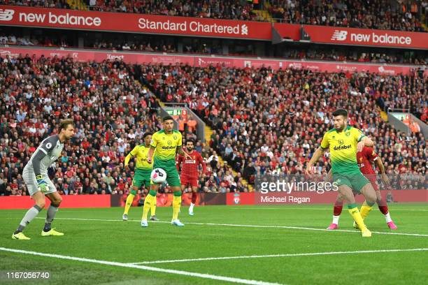 Grant Hanley of Norwich City scores an own goal during the Premier League match between Liverpool FC and Norwich City at Anfield on August 09 2019 in...